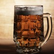 Glass of beer over wooden surface - Photo