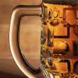 Glass of beer over wooden surface - 图库照片