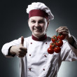 Happy chef with tomatoes — Stock Photo