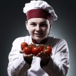 Happy chef with tomatoes — Stock Photo #9969437