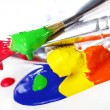 Colorful paint and brushes — Stok fotoğraf