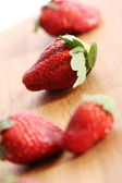 Strawberries on wooden surface — Stock Photo