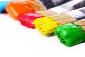 Colorful paint and brushes — Stock Photo