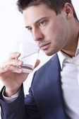 Businessman with glass of water — Stock fotografie