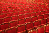 Rows of red chairs — Stock Photo