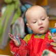 The child draws a finger paints — Stock Photo