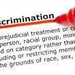 Discrimination underlined with red marker - Stock Photo