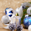Blue and white christmas balls with silver candle — Stock Photo #10097192