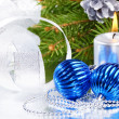 Blue christmas balls and silver candle — Stock Photo #10184898