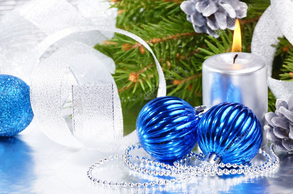 Blue Christmas balls with silver candle over bright background — Stock Photo #10184898