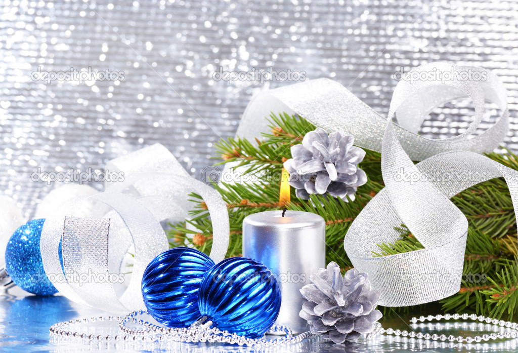 Blue Christmas balls with silver candle over bright background — Stock Photo #10357642