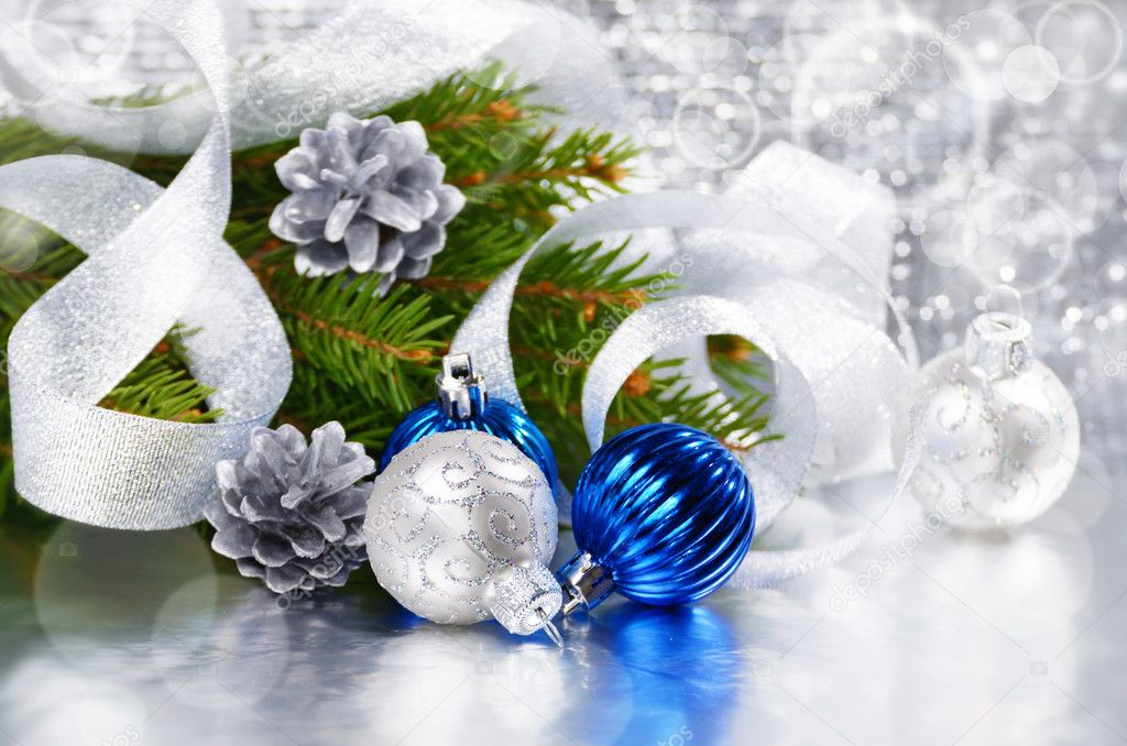 Blue and silver Christmas balls over bright background — Stock Photo #10549862