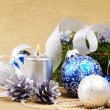 Stock Photo: Blue and white christmas balls with silver candle