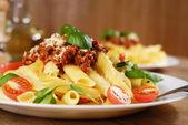 Pasta rigatoni on the white plate — Stock Photo