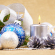 Blue and white christmas balls with silver candle — Stock Photo #9849110