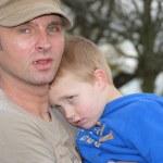 Father holding sad son — Stock Photo