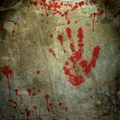 Background with a print of a bloody hand — Stock Photo