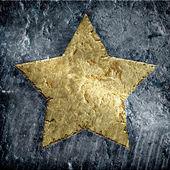 Gold metallic grunge star — Stock Photo