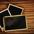Stock Photo: Old photo frames on wood background