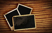 Old photo frames on wood background — Stock Photo
