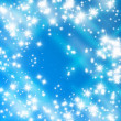 Stock Photo: Bright glitters on soft blue