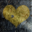 Gold metallic grunge pierced heart — Stock Photo