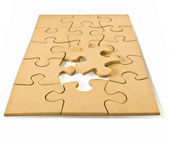 Wooden puzzles — Stock Photo