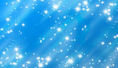 Bright glitters on a soft blue — Stock Photo