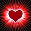 Stock Photo: Red heart with rays on black
