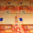 Stock Photo: Tortuous background of euro banknotes
