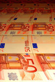 Tortuous background of euro banknotes — Stock Photo