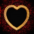 Stock Photo: Gold picture frame in shape of heart