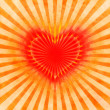 Red heart with rays on a grunge background — Stock Photo #9815085