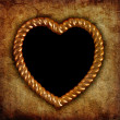 Gold picture frame in shape of heart — Stock Photo
