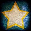 Star on dark grunge background — Stock Photo
