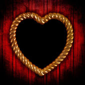 Gold picture frame in shape of heart — 图库照片