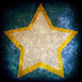 Karanlık grunge arka plan üzerinde star — Stok fotoğraf