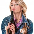 Young girl with a gun — Stock Photo