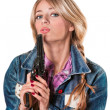 Stock Photo: Young girl with a gun
