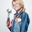 Girl with a wrench — Stock Photo