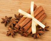 Anise star and several cinnamon sticks — Stock Photo