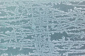 Frost patterns on window — Stock Photo