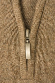 Zipper on the wool fabric textile — Stock Photo