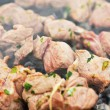 Meat grilling over charcoal — Stock Photo #10490023