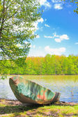Old boat at the riverside — Stock Photo