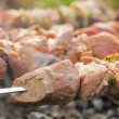 Meat grilling over charcoal — Stock Photo
