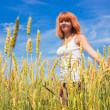 Beautiful young woman walking at wheat field — Stock Photo #8664966