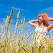 Beautiful young woman at wheat field — Stock Photo #8668676