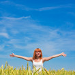 Beautiful young woman at wheat field — Stock Photo #8767730