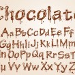 Dark chocolate alphabet on a white background. - Stock Vector
